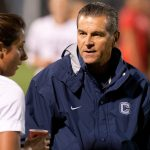 Women's Soccer Coach Len Tsantiris talks to Danielle Schulmann in 2012. (Stephen Slade '89 (SFA) for UConn)