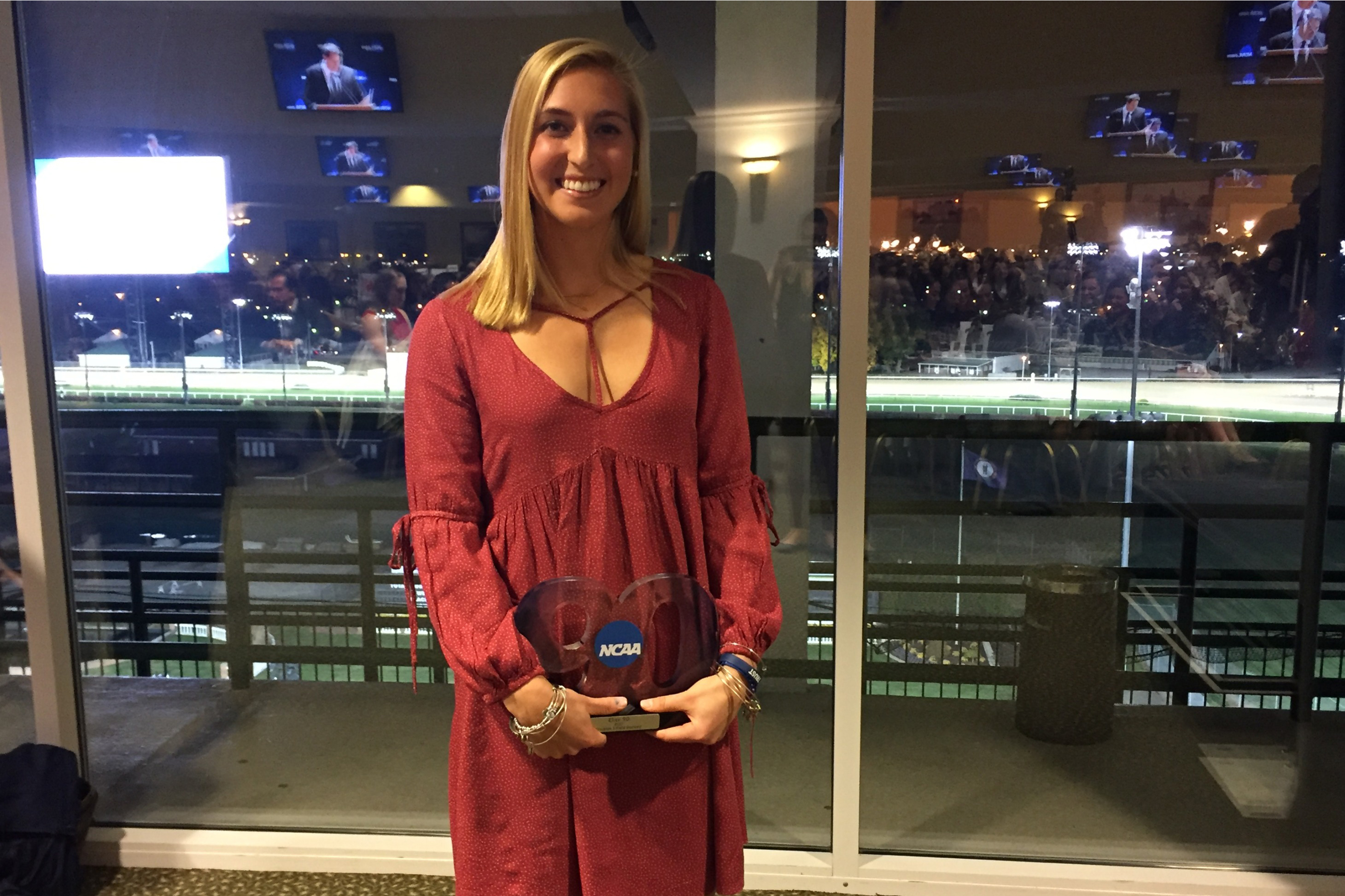 Ashley Rich poses with her NCAA Elite 90 award at the NCAA Field Hockey banquet on Nov. 23 in Louisville, Kentucky. (Alexandra Greene/UConn Photo)