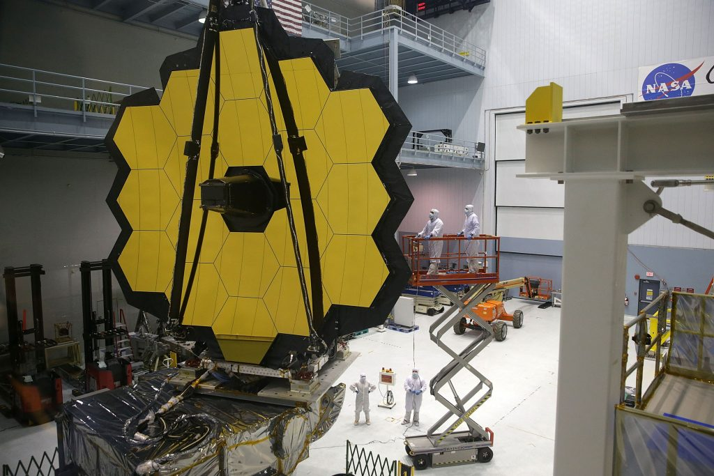 Engineers and technicians assemble the James Webb Space Telescope on Nov. 2, 2016 at NASA's Goddard Space Flight Center in Greenbelt, Maryland. The telescope, designed to be a large space-based observatory optimized for infrared wavelengths, will be the successor to the Hubble Space Telescope and the Spitzer Space Telescope. (Photo by Alex Wong/Getty Images)