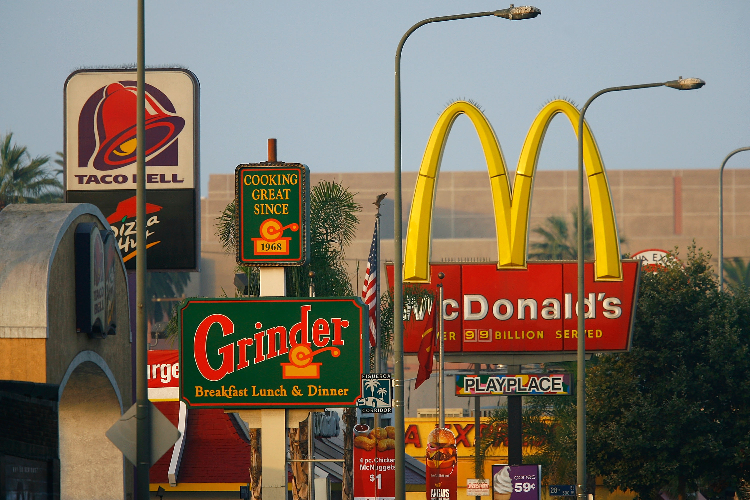 Fast food restaurants thrive in one of the poorest areas of Los Angeles. South LA has the highest concentration of fast-food restaurants of the city, about 400, and only a few grocery stores. (Photo by David McNew/Getty Images)
