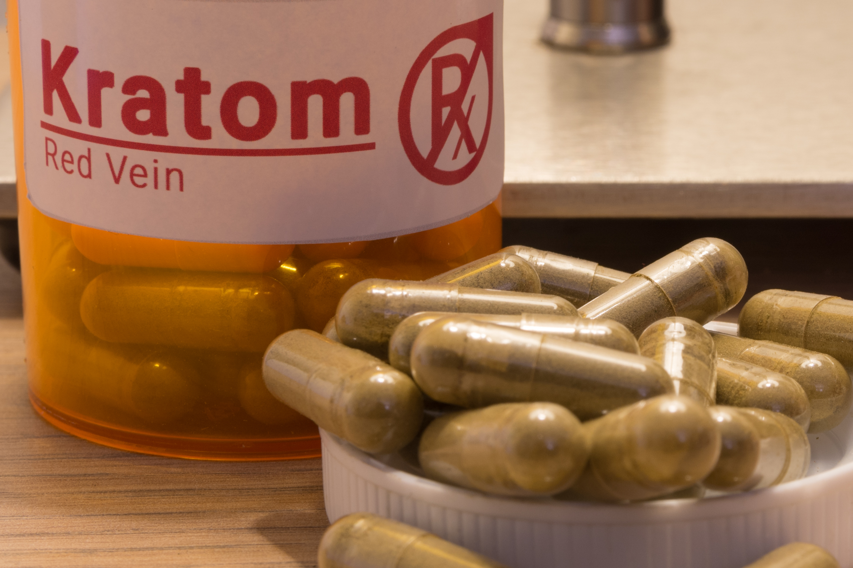 Image of actual kratom pills with a faux prescription logo. (Getty Images)