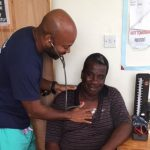UConn Health's Dr. Hynes Birmingham works with a patient in Dominica after Hurricane Maria. (Photo courtesy of Dr. Birmingham)