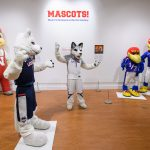 Jonathan the Husky, UConn's current mascot visits the exhibit 'Mascots! Mask Performance in the 21st Century' at the Ballard Institute and Museum of Puppetry. (Peter Morenus/UConn Photo)