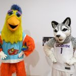 Jonathan the Husky, UConn's current mascot, right, poses with the Famous San Diego Chicken. (Peter Morenus/UConn Photo)