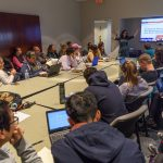 Cynthia DeRoma, an adjunct English faculty member, leads a discussion on a recent viral video and issues of diversity in primary education during a UConn Metanoia event titled 'Who Are the Trolls Really Trolling?' (Peter Morenus/UConn Photo)