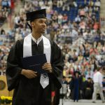 Shabazz Napier '14 (CLAS) walks across the floor at Gampel Pavilion after receiving his diploma case during the midday College of Liberal Arts and Sciences commencement ceremony on May 11, 2014. (Peter Morenus/UConn Photo)