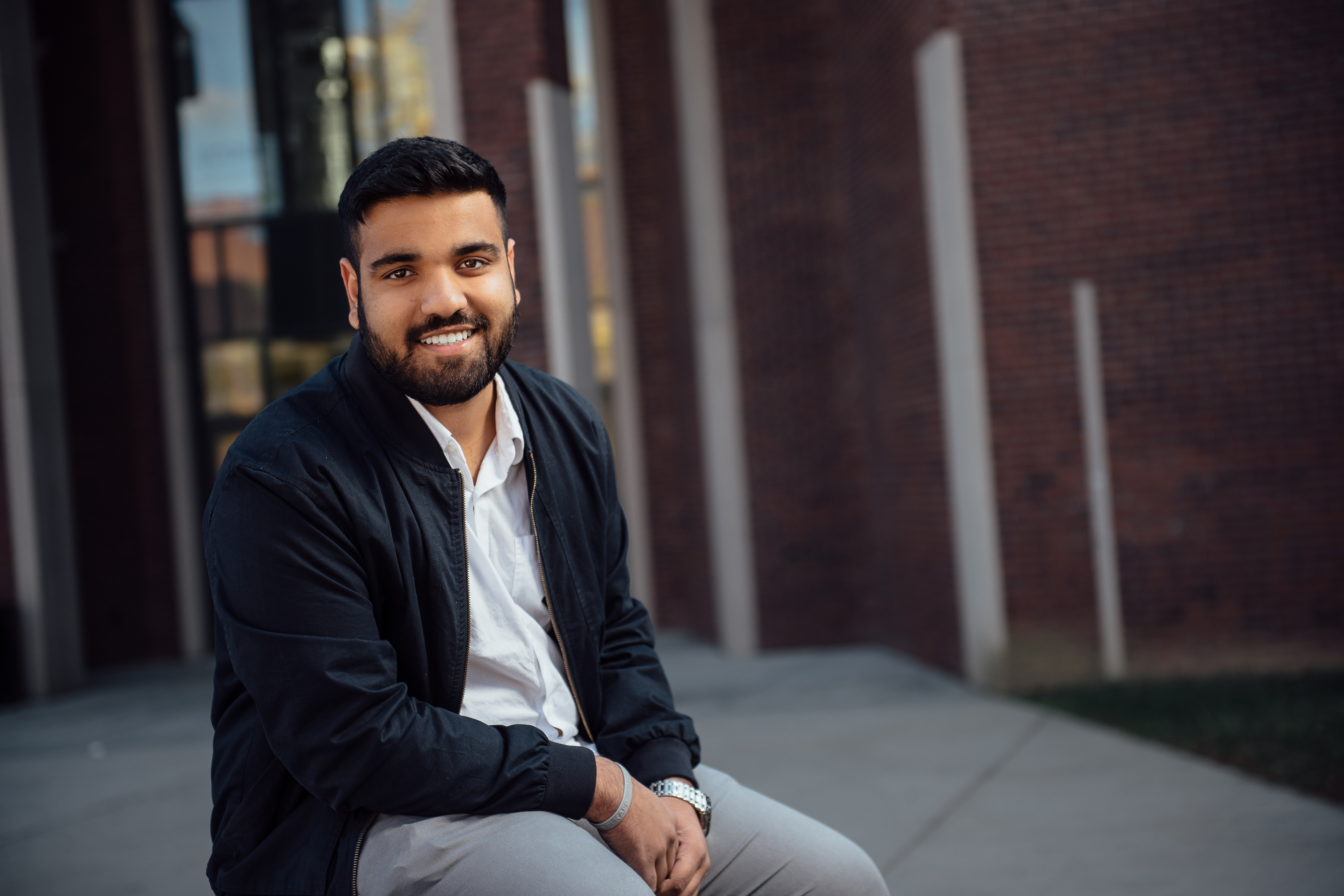 Joel Thomas, an international student from Dubai, outside the School of Business. (Nathan Oldham/UConn Photo)