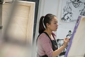 Amanda Pan, a pre-pharmacy sophomore, works on her painting in Professor Guarino's class. (Garrett Spahn/UConn Photo)