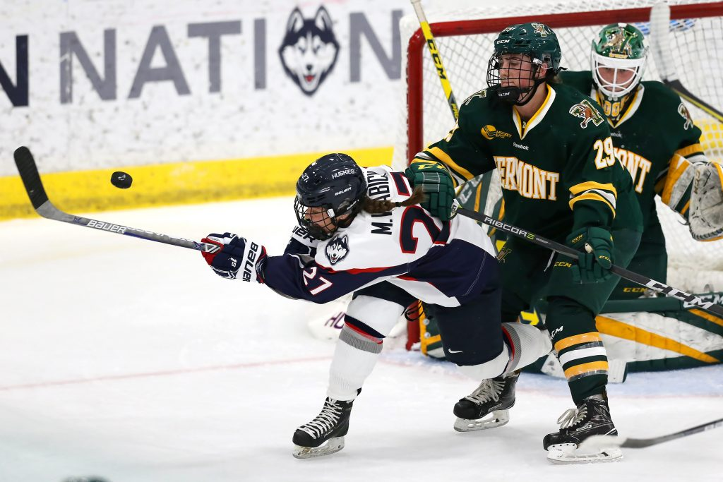 Morgan Wabick (27) on the offensive attack against Vermont at the Freitas Ice Forum on Oct. 7. (Stephen Slade '89 (SFA) for UConn)