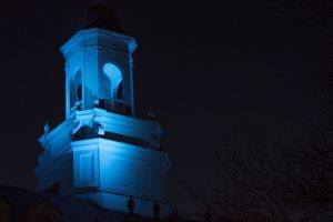 Wilbur Cross lit in teal to raise awareness for Alzheimer's Disease. (Garrett Spahn/UConn Photo)