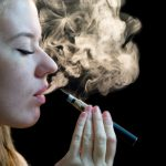 Woman inhaling from an electronic cigarette. (Getty Images)