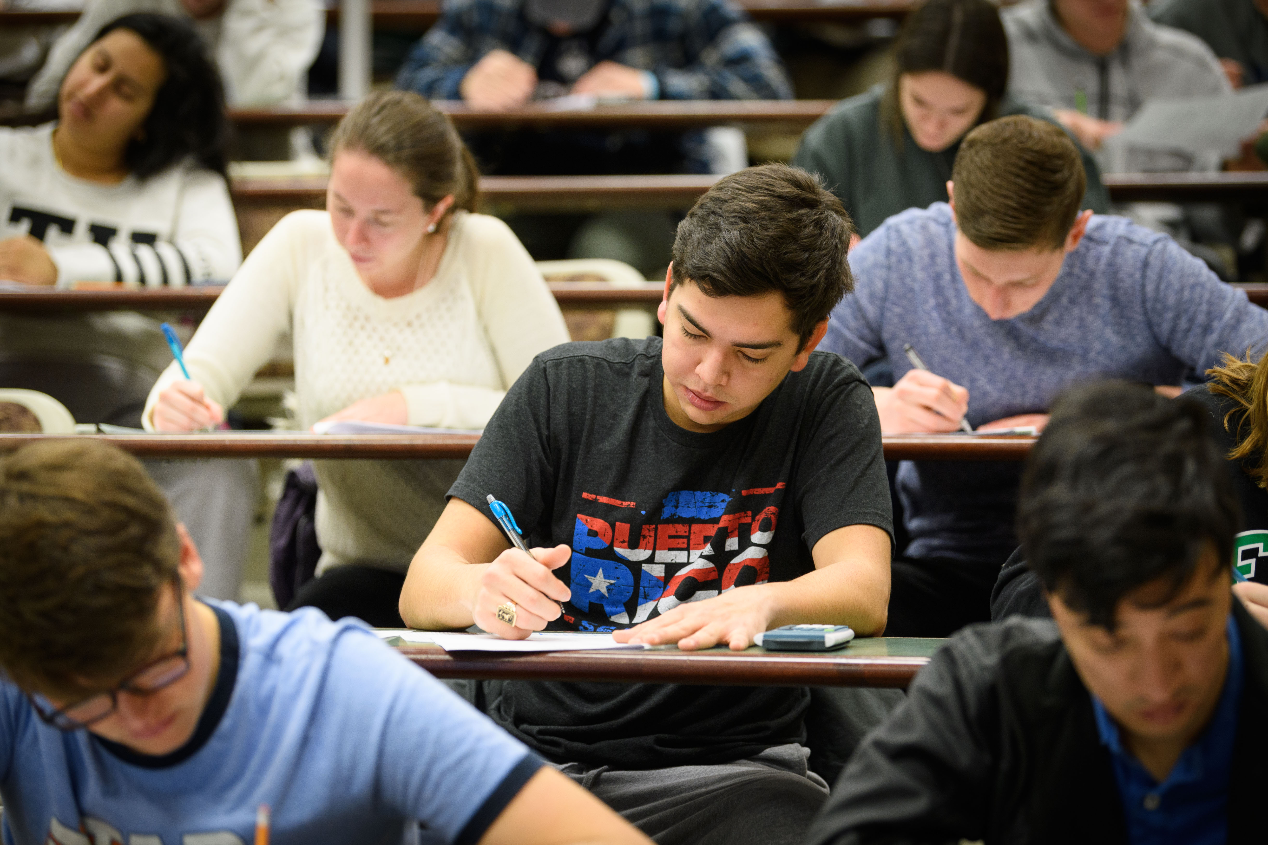 Sophomore Daniel Cintron takes a final exam at the Physics Building on Dec. 15, 2017. (Peter Morenus/UConn Photo)
