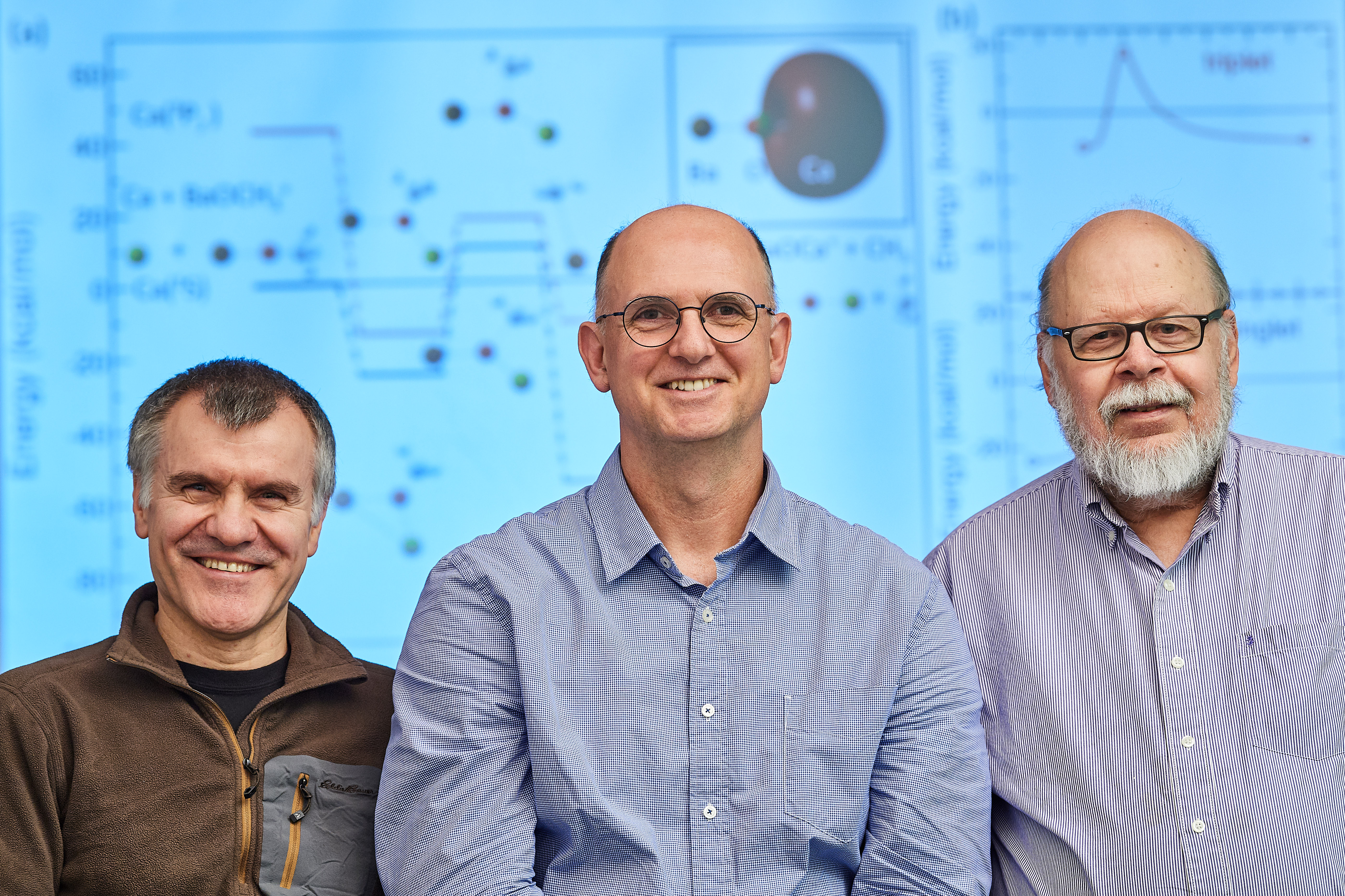 Ionel Simbotin, left, a postdoctoral fellow, Robin Côté, associate dean and professor of physics, and John Montgomery Jr., research professor. (Peter Morenus/UConn Photo)