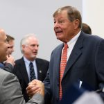 Peter J. Werth, right, shakes hands with David Benedict, director of UConn Athletics,  following an event to announce a $22.5 million commitment to the University and the naming of the Peter J. Werth Residence Tower. (Peter Morenus/UConn Photo)