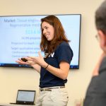 Graduate student Stephanie Knowlton '15 (ENG) of mBiotics LLC gives a presentation during the  Entrepreneurial & Innovation Student Huddle held at the newly named Peter J. Werth Residence Tower on Dec. 4. Knowlton's company is developing a 3-D printing solution for personalized medicine. (Peter Morenus/UConn Photo)