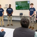 Colton Kopcik '19 (CLAS) left, Chibuike Ukwuoma '19 (BUS), Craig Carlson '19 (CLAS), and Shayla Morris '19 (CLAS) of Healthy Roots speak about their efforts to develop a certification for best farm labor practices during the Entrepreneurial & Innovation Student Huddle. (Peter Morenus/UConn Photo)