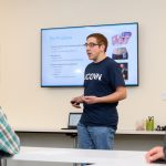Graduate student Ryan Ouimet '14 (ENG) of MediSense explains the development of a tool to detect diabetes using the breath of a patient during the Entrepreneurial & Innovation Student Huddle. (Peter Morenus/UConn Photo)