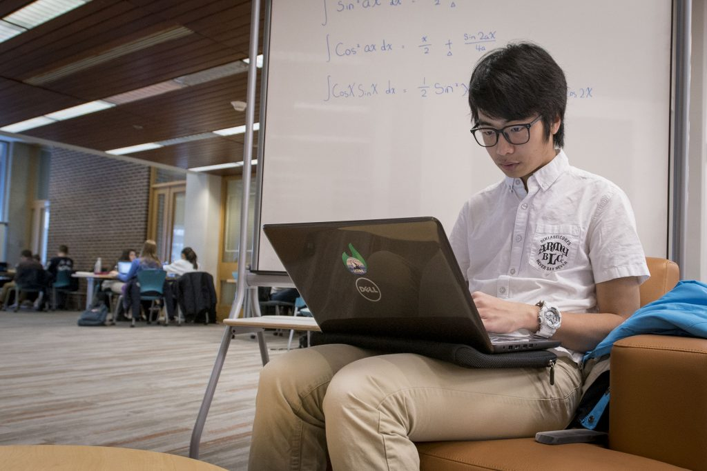International Student Wei 'Toby' Xinhai studying math at the Homer Babbidge Library on Dec. 12, 2017. (Sean Flynn/UConn Photo)