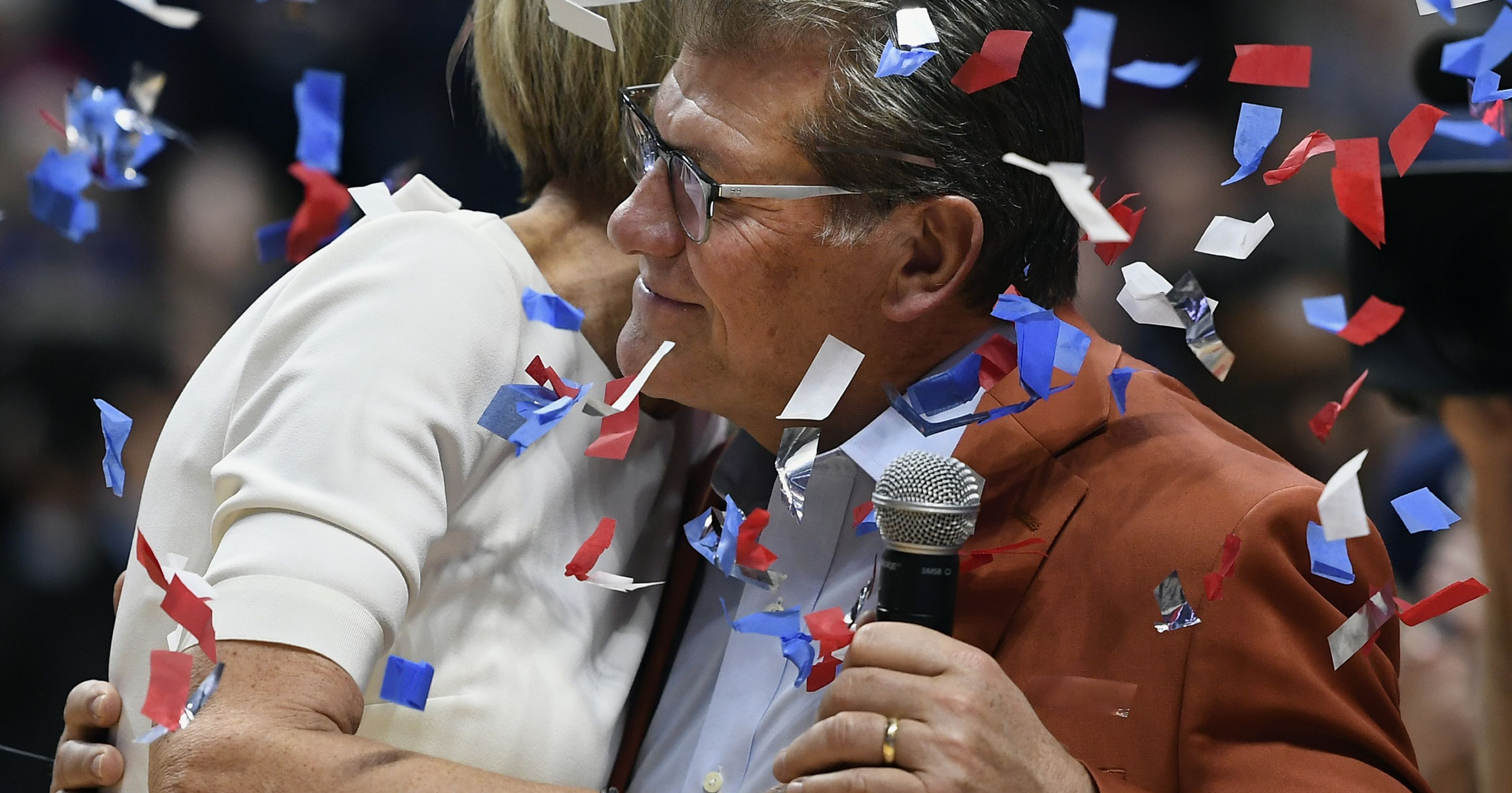 Chris Dailey and Geno Auriemma celebrate after their 1,000 win. (Associated Press)