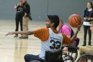 Sophomore Alex Abraham, a finance major, plays wheelchair basketball. (Garrett Spahn '18 (CLAS)/UConn Photo)