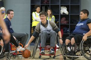 Eric Duwitt, a freshman majoring in civil engineering, plays wheelchair basketball. (Garrett Spahn '18 (CLAS)/UConn Photo)