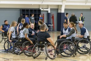 Students huddle for wheelchair basketball at the Student Recreation Center on Nov. 30. (Garrett Spahn '18 (CLAS)/UConn Photo)