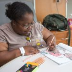 A local artist is brightening the holiday season using his coloring books as art therapy for his fellow UConn Health patients living with sickle cell and other diseases. (Tina Encarnacion/UConn Health Photo)
