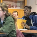 Student-athlete Mamadou Diarra, Men's Basketball, in a History of Immigrants course taught by assistant professor Jason Chang at the Asian American Cultural Center on Dec. 7, 2017. (Sean Flynn/UConn Photo)