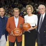 Geno Auriemma and Chris Dailey pose with Athletics Director David Benedict, far left, and former Men's Basketball head coach Dee Rowe, far right, as they celebrate their 1,000th win.