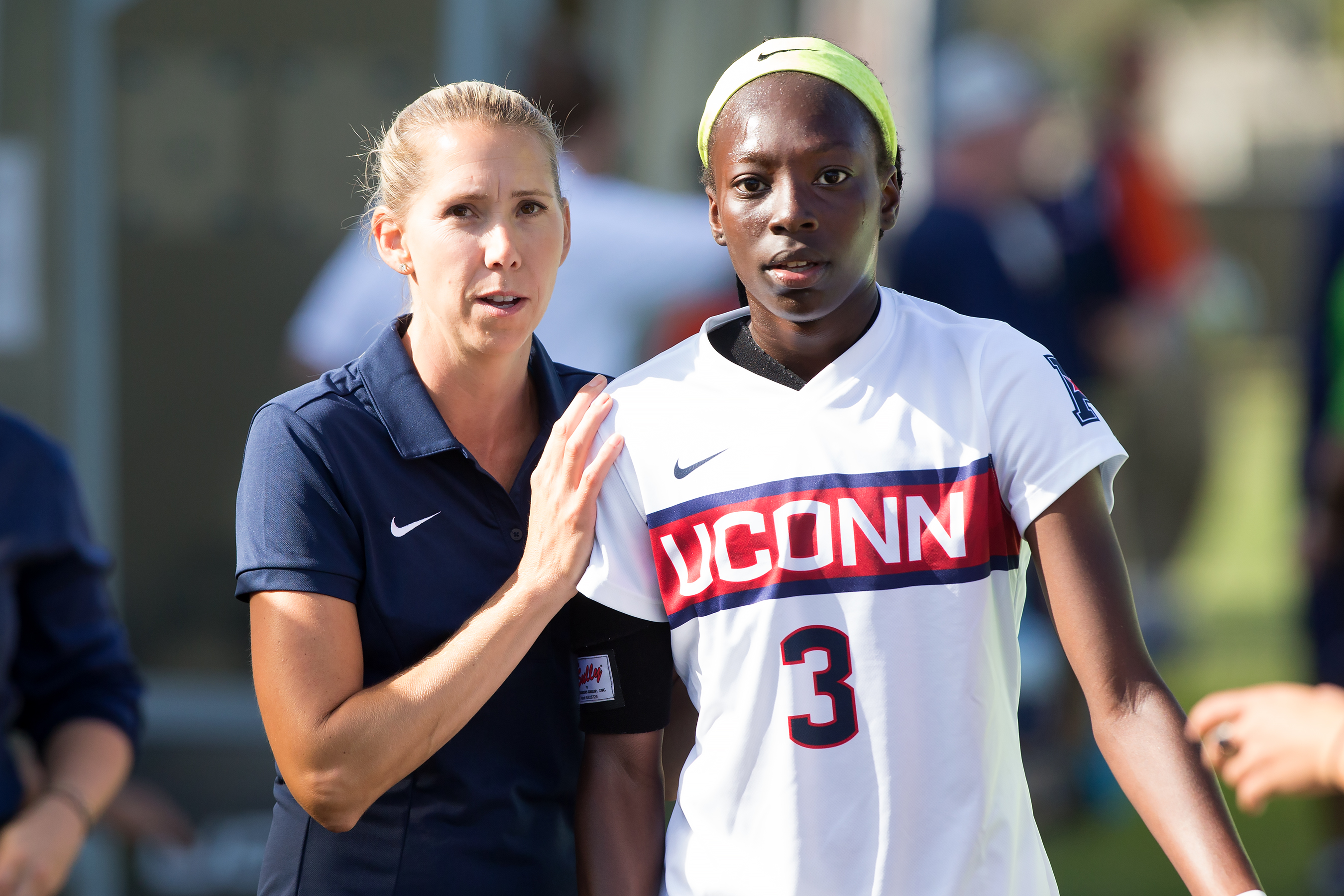 Margaret (Tietjen) Rodriguez with player Yamilee Eveillard. (Stephen Slade '89 (SFA) for UConn)