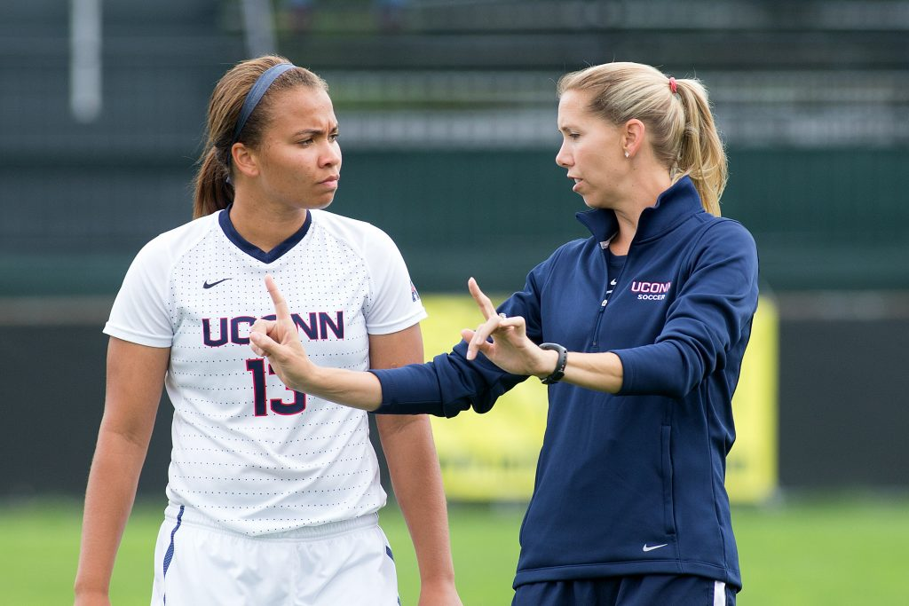 Margaret (Tietjen) Rodriguez, new head coach of women's soccer, with player Toriana Patterson. (Stephen Slade '89 (SFA) for UConn)