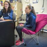 Student-athlete Courtney Akerley '19 (CLAS) meets with her academic adviser, Lindsay Darcy, in Hall Dorm. (Sean Flynn/UConn Photo)