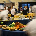 Chefs select vegetables, spices, and condiments. (Peter Morenus/UConn Photo)