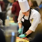 Brooke Senechal of McMahon dining slices potato skins. (Peter Morenus/UConn Photo)