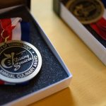 Medals to be awarded to winning teams at UConn Dining's 18th annual Culinary Competition. First place went to the Putnam team of Mathew Nichols, Bill McKay, and Hannah Lee. (Peter Morenus/UConn Photo)