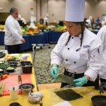 Susan Palmes of Buckley dining prepares to use a sheet of nori seaweed. (Peter Morenus/UConn Photo)