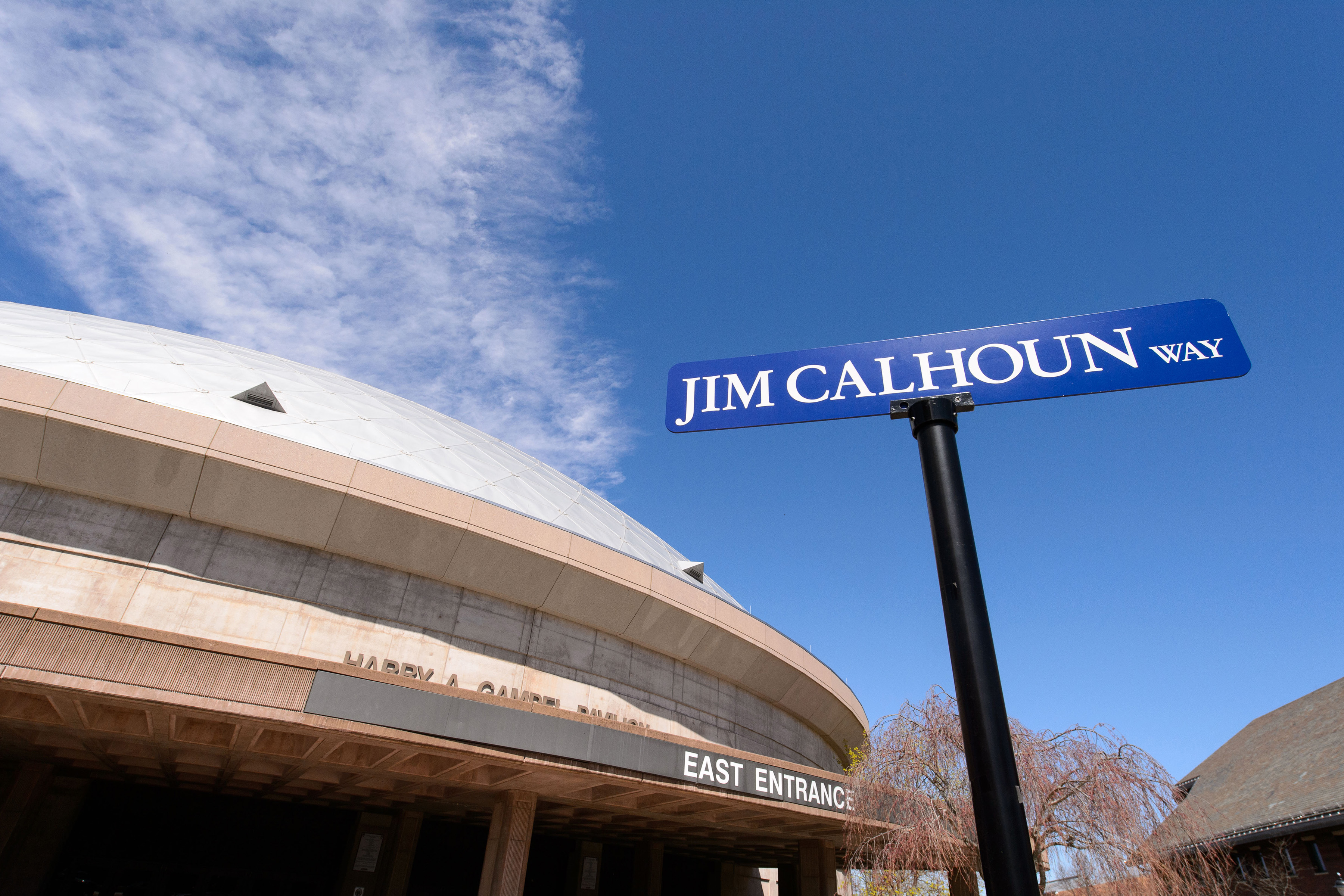 A view of Gampel Pavilion and the Jim Calhoun Way sign on April 29, 2015. (Peter Morenus/UConn Photo)