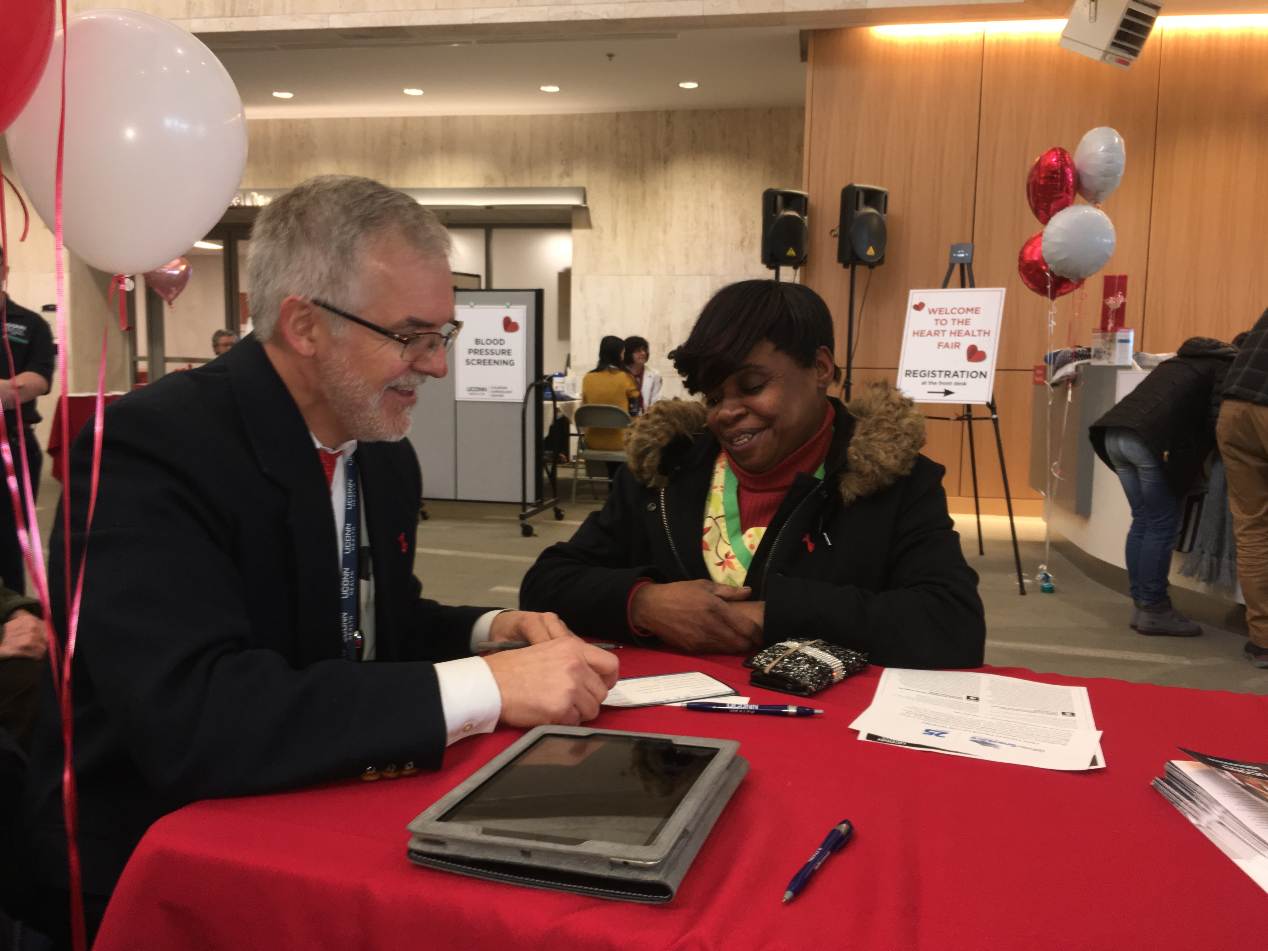 Chir-lane Johnson of New Britain gets the results of her free screenings and a personalized heart health assessment at UConn Health's Heart Health Fair on National Wear Red Day on Feb. 2 (UConn Health Photo/Lauren Woods).