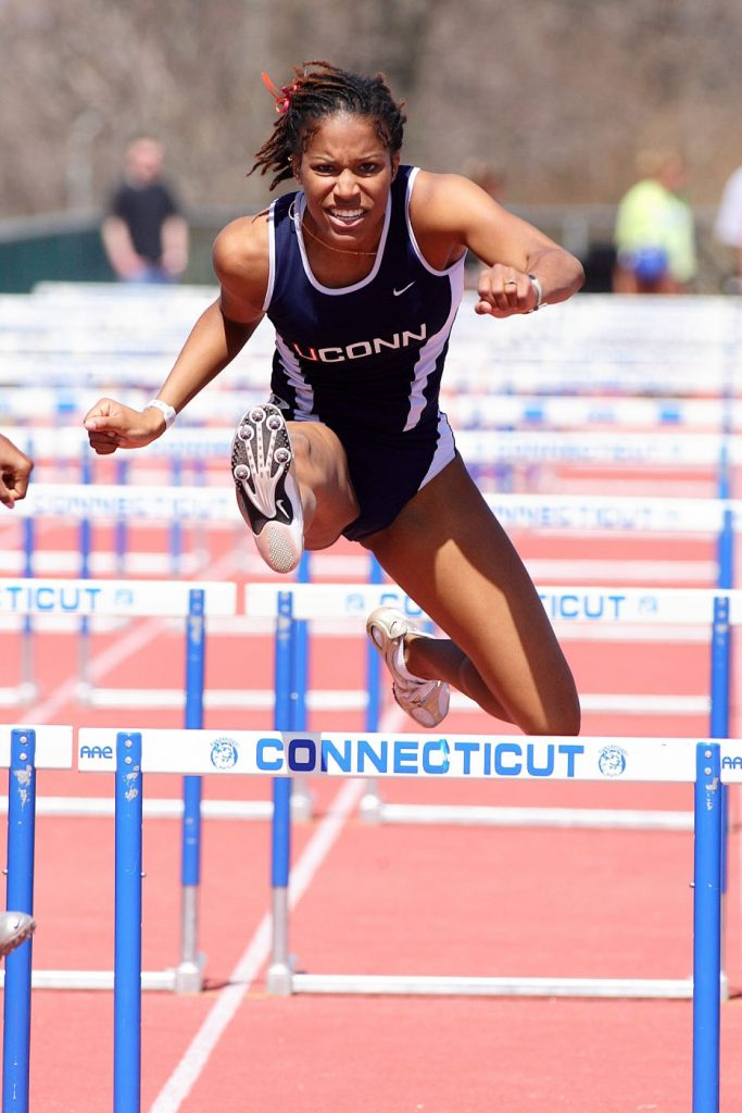 Former UConn women's track-and-field standout Phylicia George competes in hurdles at UConn. (File photo by Stephen Slade '89 (SFA) for UConn)