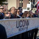 UConn marked a milestone in the construction of the new Student Recreation Center with a topping off ceremony Feb. 27, as the final beam was hoisted into place. Here, UConn Recreation employees pose for a photo with the signed beam that was installed during the event. The building is scheduled for completion in summer 2019. (Peter Morenus/UConn Photo)
