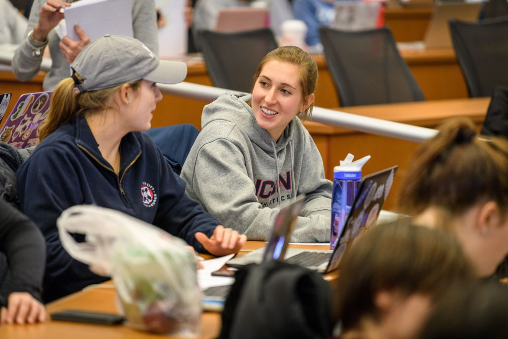 Ashley Rich '20 (NUR) speaks with a classmate during a nursing class at the Carolyn Ladd Widmer Wing of Storrs Hall on Feb. 1, 2018. (Peter Morenus/UConn Photo)