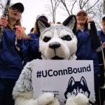 Accepting our incoming class is not something we at UConn take lightly. On Feb. 23, Jonathan the Husky delivered an admission letter to a student, feted by members of the UConn Marching Band and accompanied by Jonathan XIV. (Bret Eckhardt/UConn Photo)