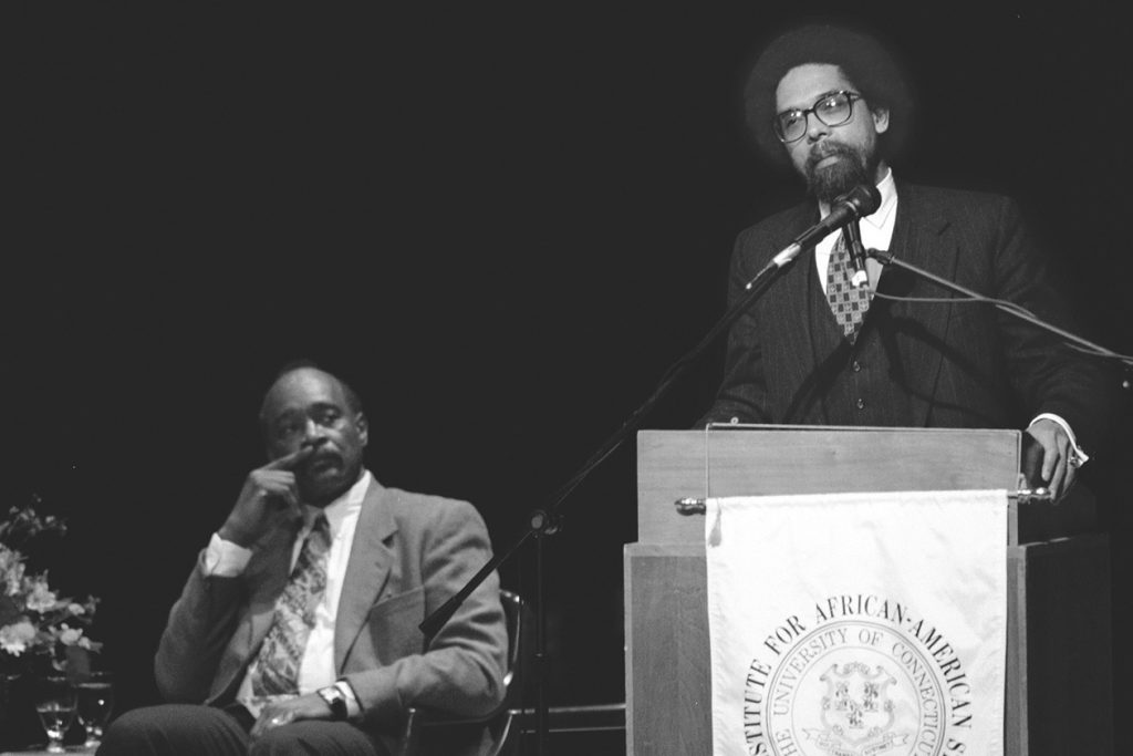 Philosopher Cornel West spoke at UConn in 1996 about racism in society. At left is Ronald Taylor, then-director of the Institute for African-American Studies. (Peter Morenus/UConn File Photo)