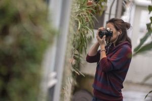 Marissa Aldieri '18 (CLAS) takes photos at the UConn Biodiversity Education and Research Greenhouses.