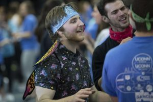 Scott Colby '18 (CLAS) dancing with friends at HuskyTHON, a dance marathon to raise money for Connecticut Children's Medical Center on  Feb. 17, 2018. (Sean Flynn/UConn Photo)