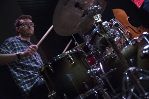 "Steven McArdle, a senior music major, plays the drums at ""Jazz Night at the Ballard"" on Feb. 20. (Garrett Spahn '18 (CLAS)/UConn Photo)"