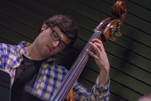 "Nathan Giordano, a senior music major, plays the bass at ""Jazz Night at the Ballard"" on Feb. 20. (Garrett Spahn '18 (CLAS)/UConn Photo)"