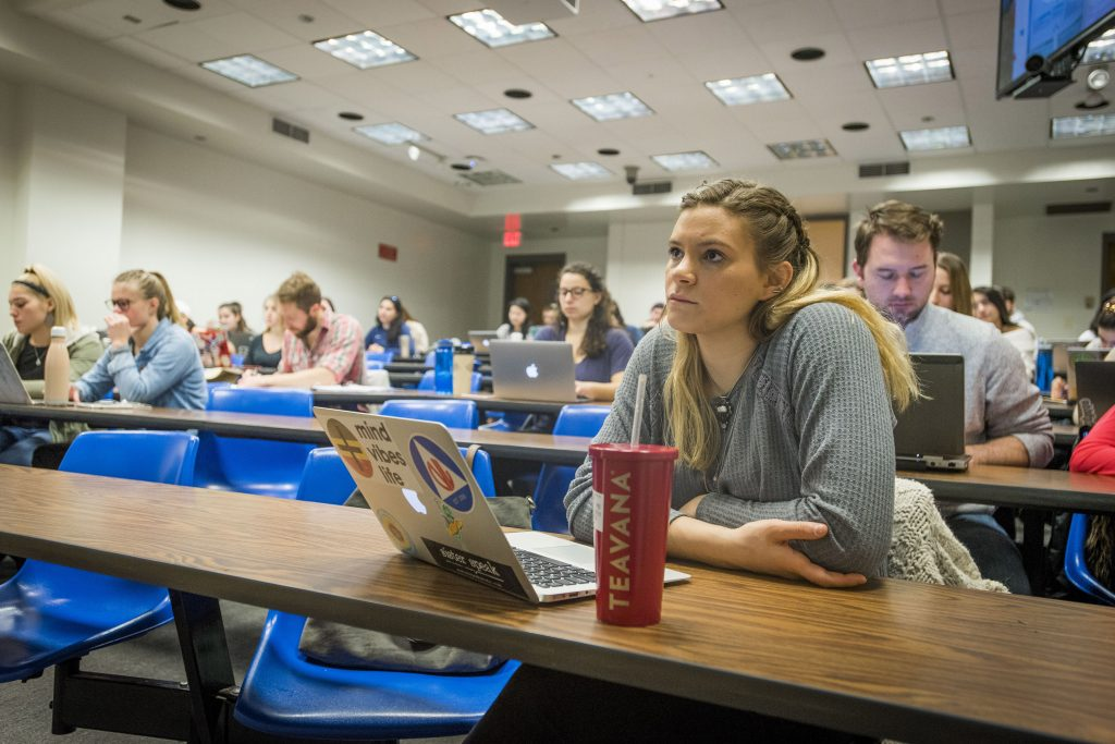 Student-athlete Monica Marcello '18 (CAHNR) listening to a Medical Therapy Nutrition lecture by Professor Nancy Rodriguez in the Engineering II Building on Feb. 28, 2018. (Sean Flynn/UConn Photo)