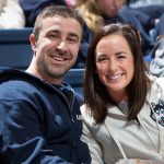 Ryan and Laura Marcoux attend a women's basketball game in Gampel Pavilion during their recent visit to Storrs. (Stephen Slade '89 (SFA) for UConn)