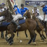 UConn and Kentucky polo players vie for the ball during the polo match at Horsebarn Hill Arena on Feb. 3, 2018. (Garrett Spahn '18 (CLAS)/UConn Photo)